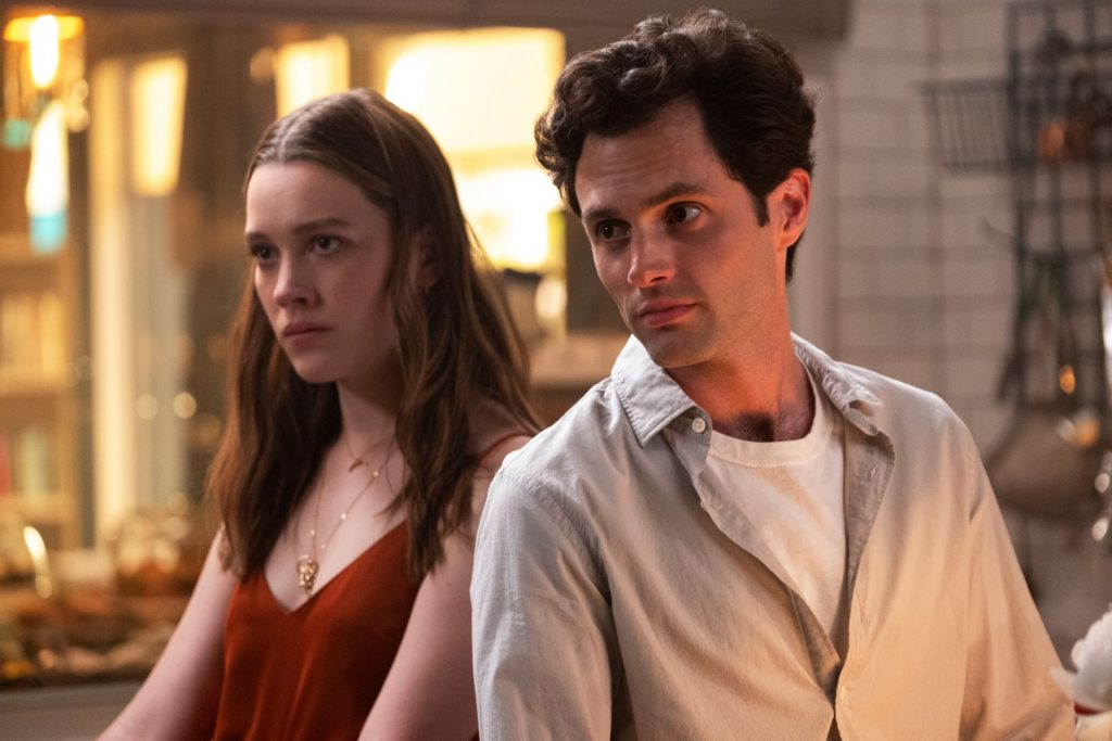 Victoria Pedretti and Penn Badgley in You