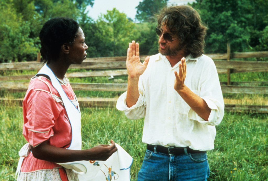 Whoopi Goldberg has conversation with Steven Spielberg off-camera from the film The Color Purple, 1985 | Warner Brothers/Getty Images