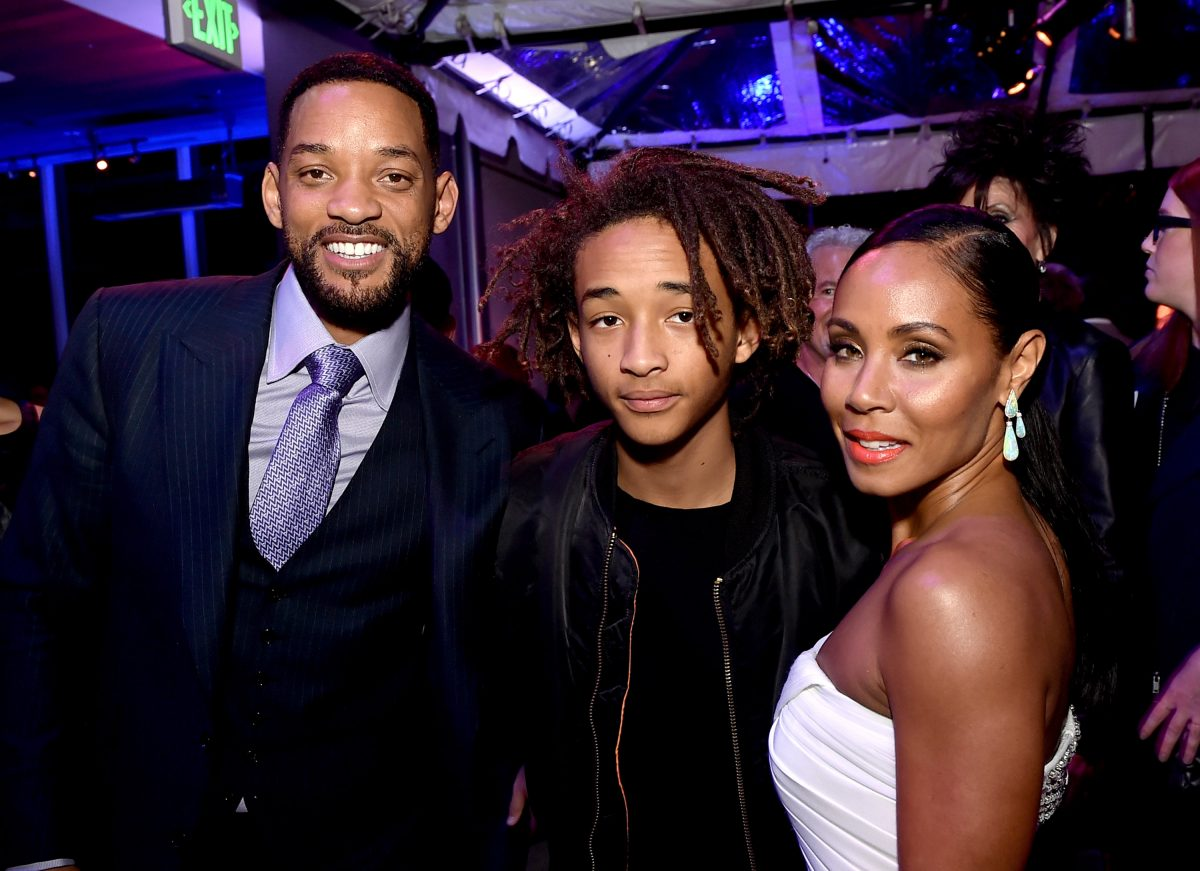 """(L-R) Actors Will Smith, son Jaden Smith and his wife Jada Pinkett Smith pose at the after party for the premiere of Warner Bros. Pictures' """"Focus"""" at the W Hotel on February 24, 2015 in Los Angeles, California."""