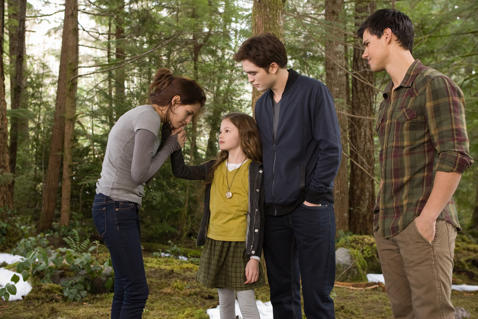 KRISTEN STEWART, MACKENZIE FOY, ROBERT PATTINSON, and TAYLOR LAUTNER in 'THE TWILIGHT SAGA: BREAKING DAWN-PART 2.'