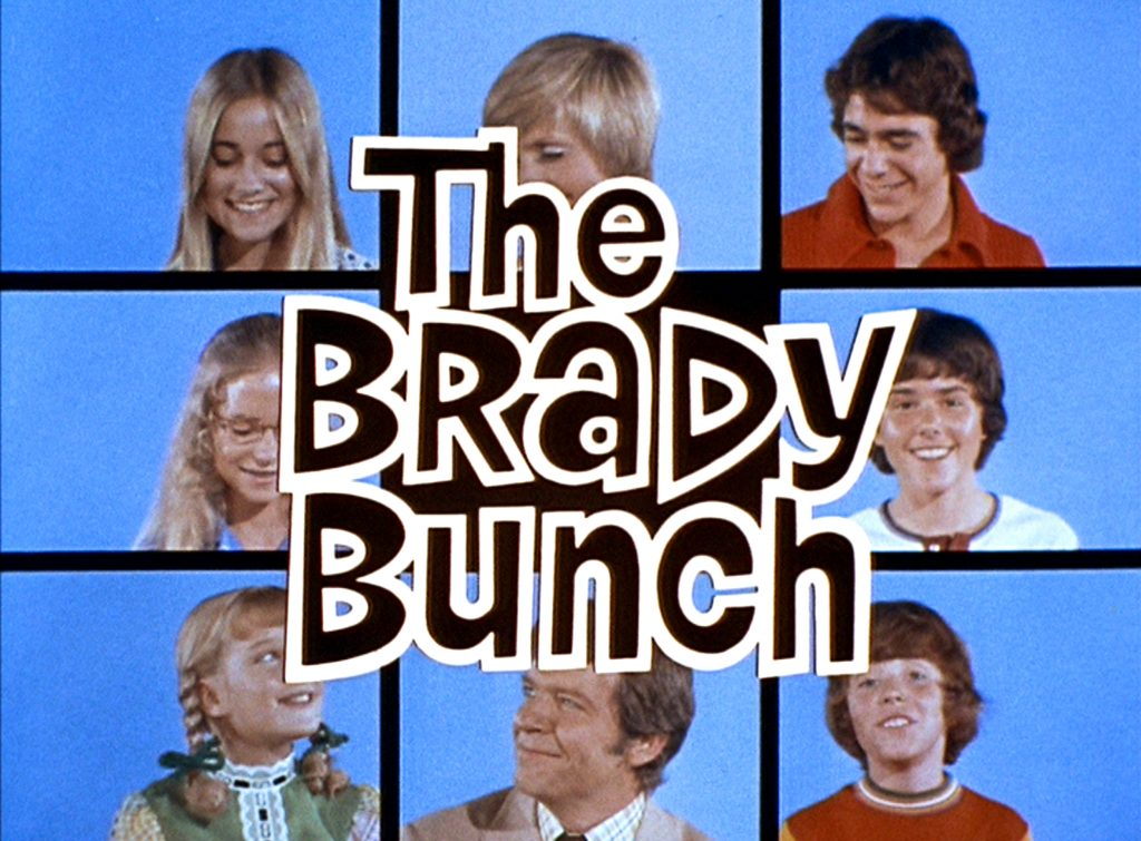 The kids from The Brady Bunch in front of a blue background