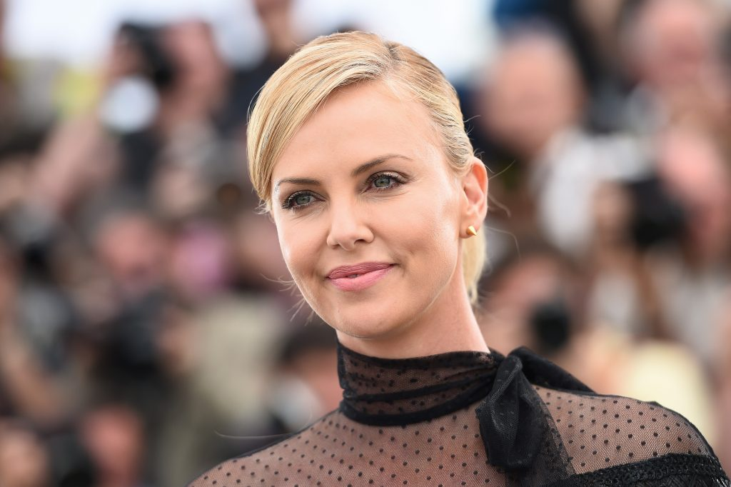 Charlize Theron poses during a photocall for the film 'Mad Max: Fury Road' during the 68th Cannes Film Festival on May 14, 2015.
