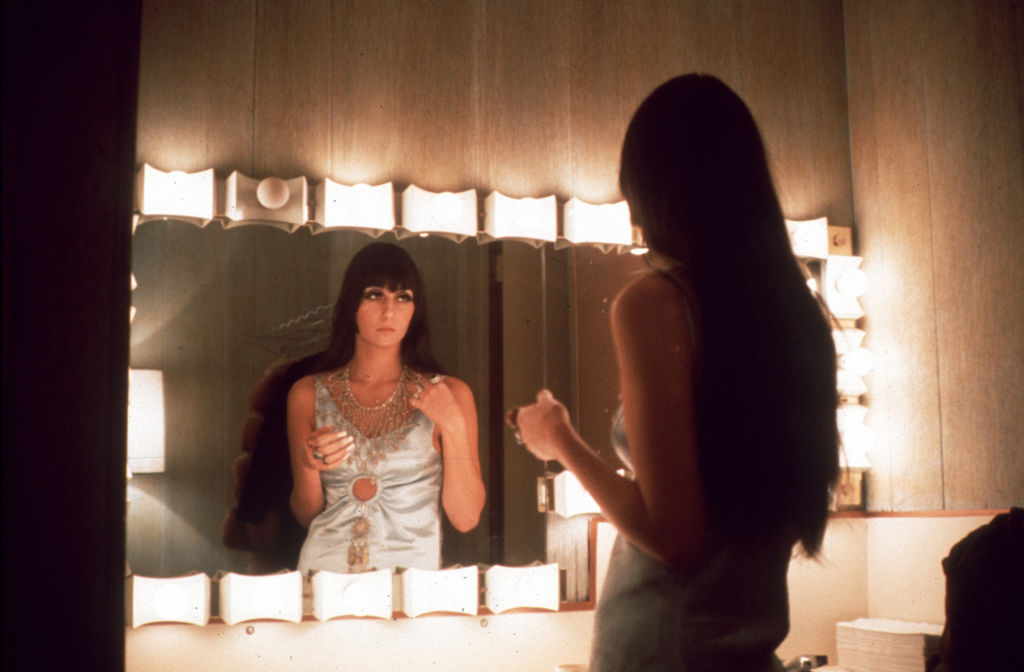 Cher at a mirror