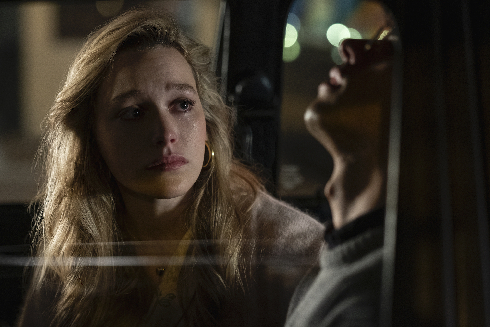 Victoria Pedretti as Dani and Roby Attal as Eddie in 'THE HAUNTING OF BLY MANOR' as she comes out to him in his car.