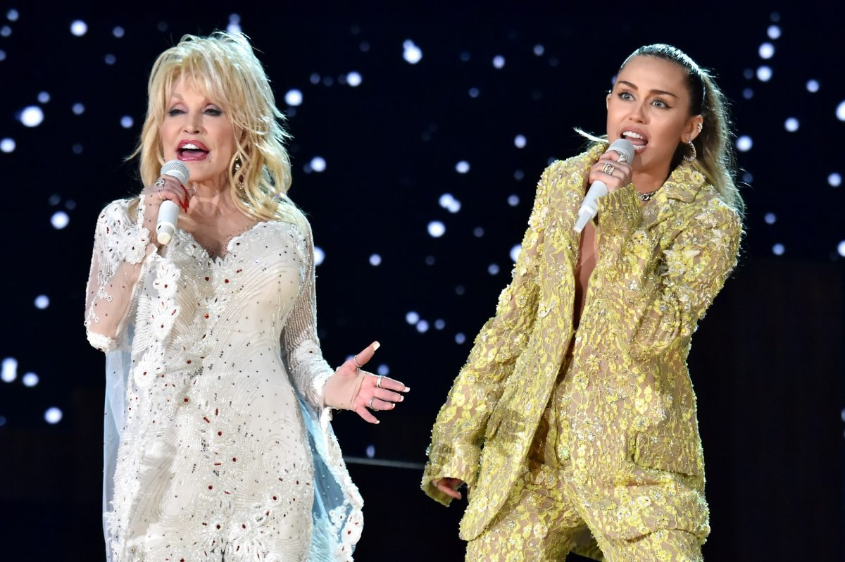 Dolly Parton (L) and Miley Cyrus perform onstage during the 61st Annual GRAMMY Awards on February 10, 2019