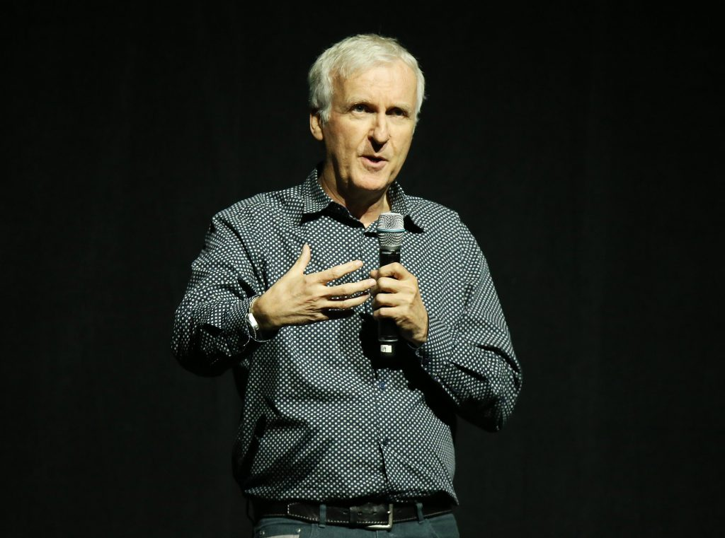 James Cameron with a microphone