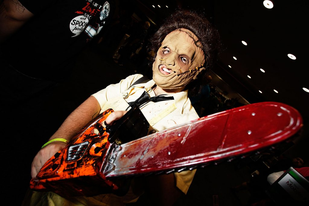 A Leatherface cosplayer with a chain saw