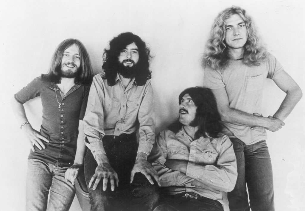 Led Zeppelin leaning against a wall