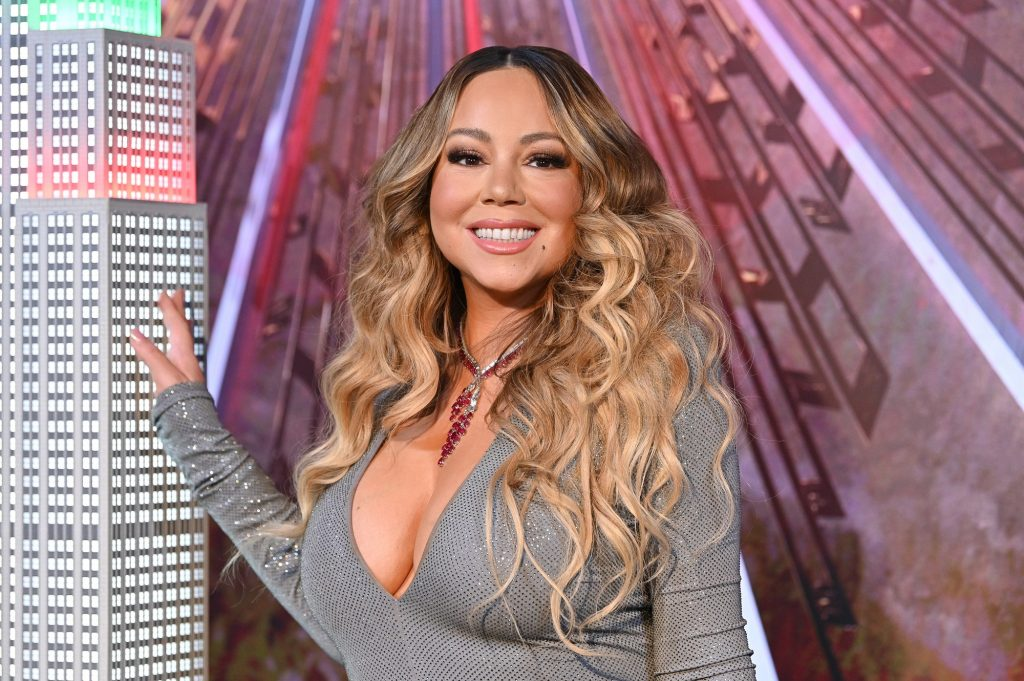 Mariah Carey lights the Empire State Building in celebration of the 25th anniversary of 'All I Want For Christmas Is You' at the Empire State Building on December 17, 2019 in New York City.