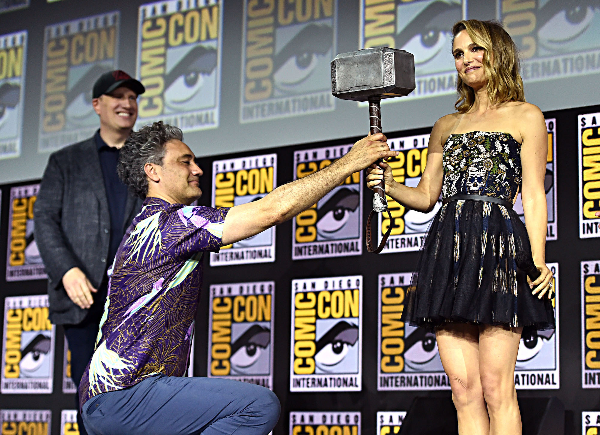 Kevin Feige, Taika Waititi, and Natalie Portman on stage at the 2019 San Diego Comic-Con, announcing news about 'Thor: Love and Thunder' on July 20, 2019.