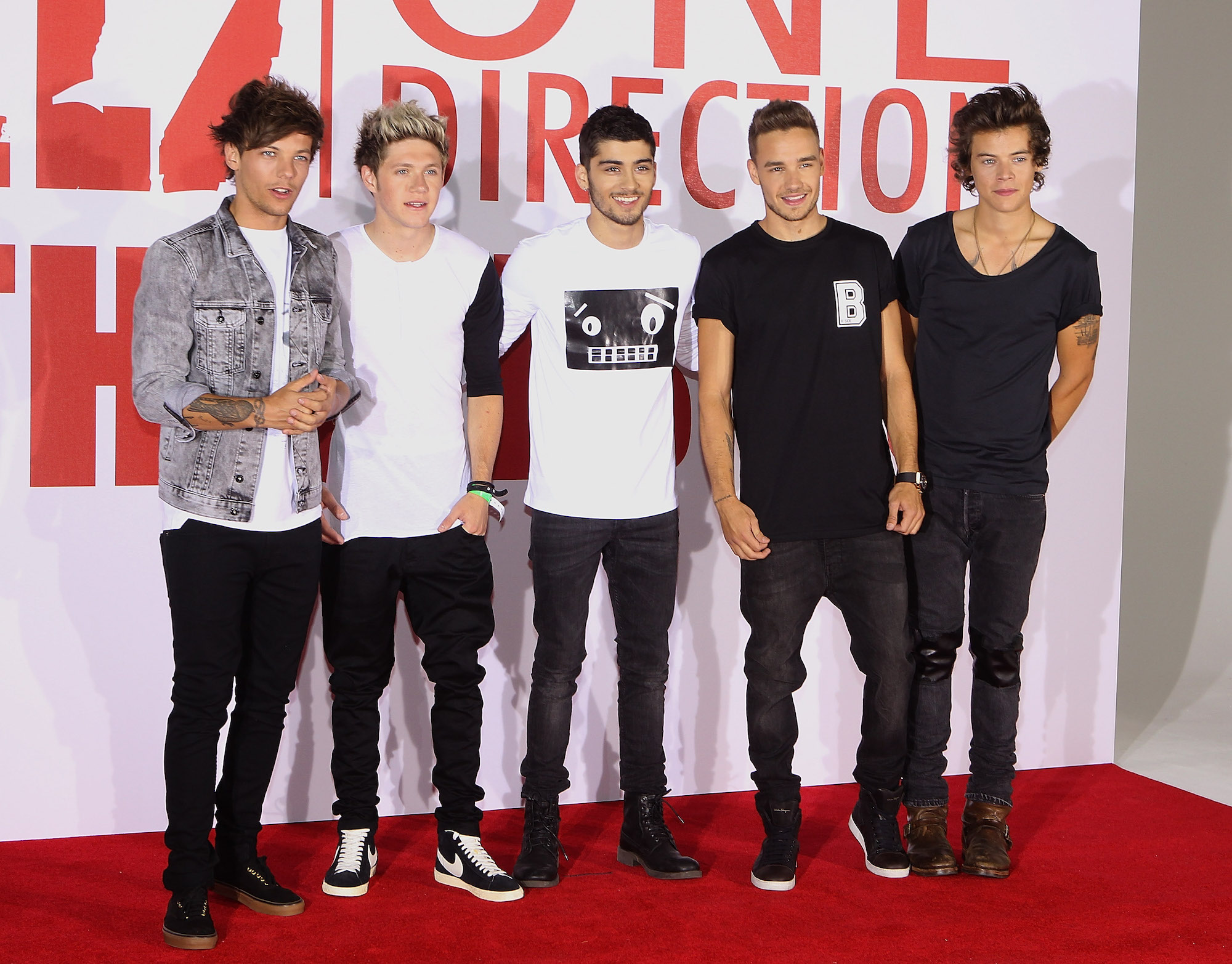 Louis Tomlinson, Niall Horan, Zayn Malik, Liam Payne, and Harry Styles of One Direction at a Photocall for their film 'This is Us' on Aug. 19, 2013