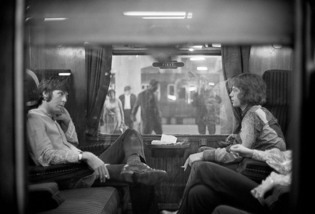 Paul McCartney and Mick Jagger on a train