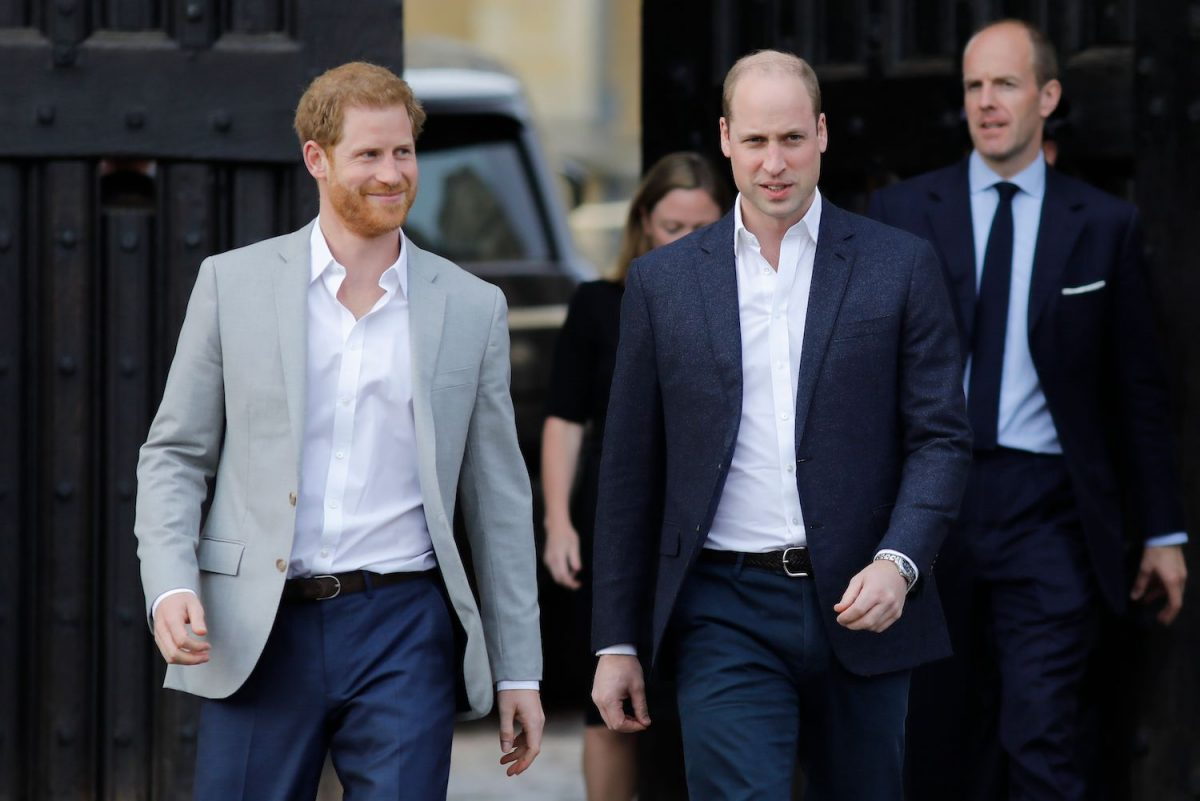 Prince Harry and Prince William arrive to greet well-wishers on the street outside Windsor Castle in Windsor on May 18, 2018, the eve of Prince Harry's royal wedding to Meghan Markle