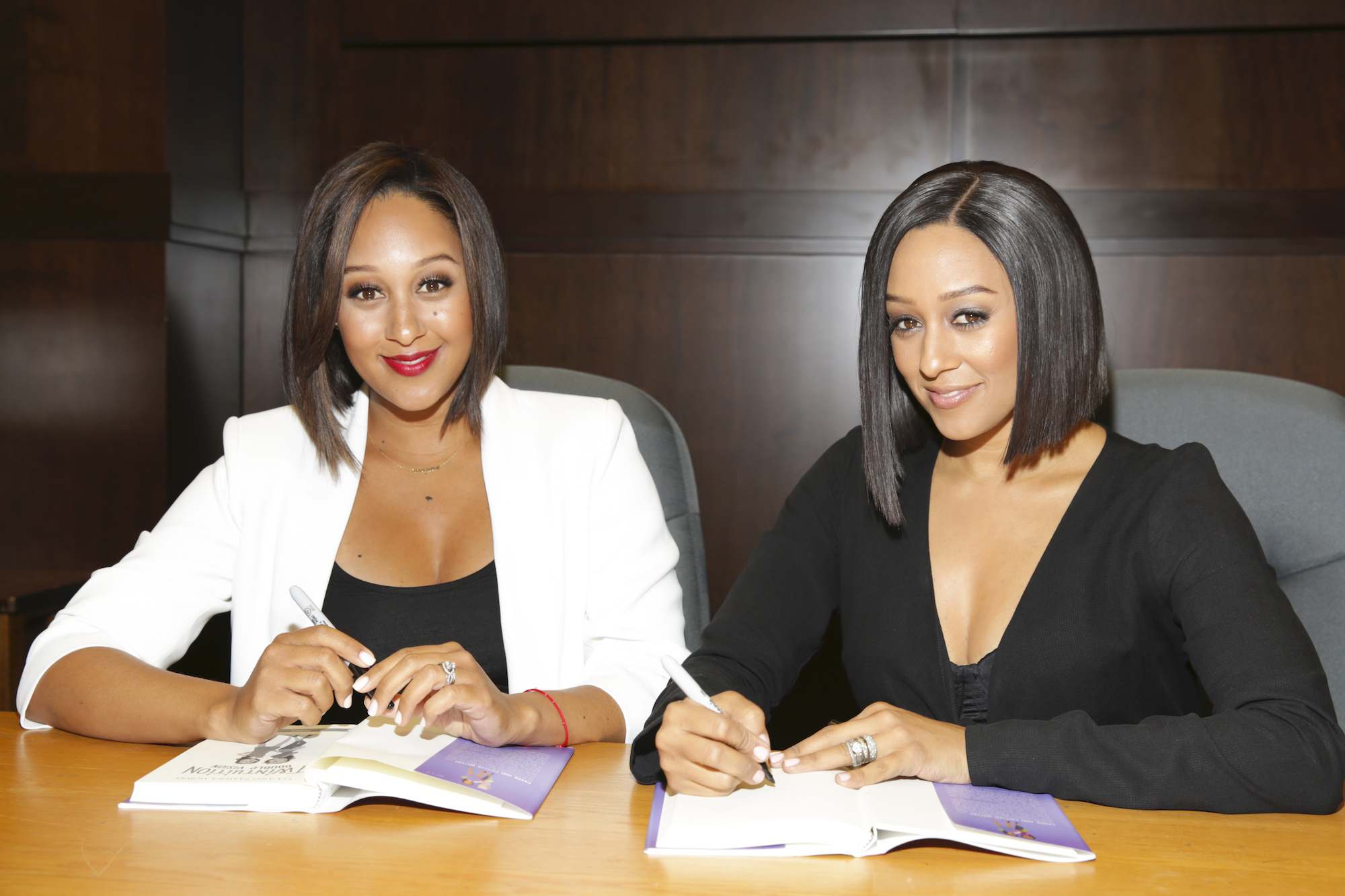 Tamera Mowry and Tia Mowry at their book signing For 'Twintuition' at Barnes & Noble at The Grove on April 21, 2015.