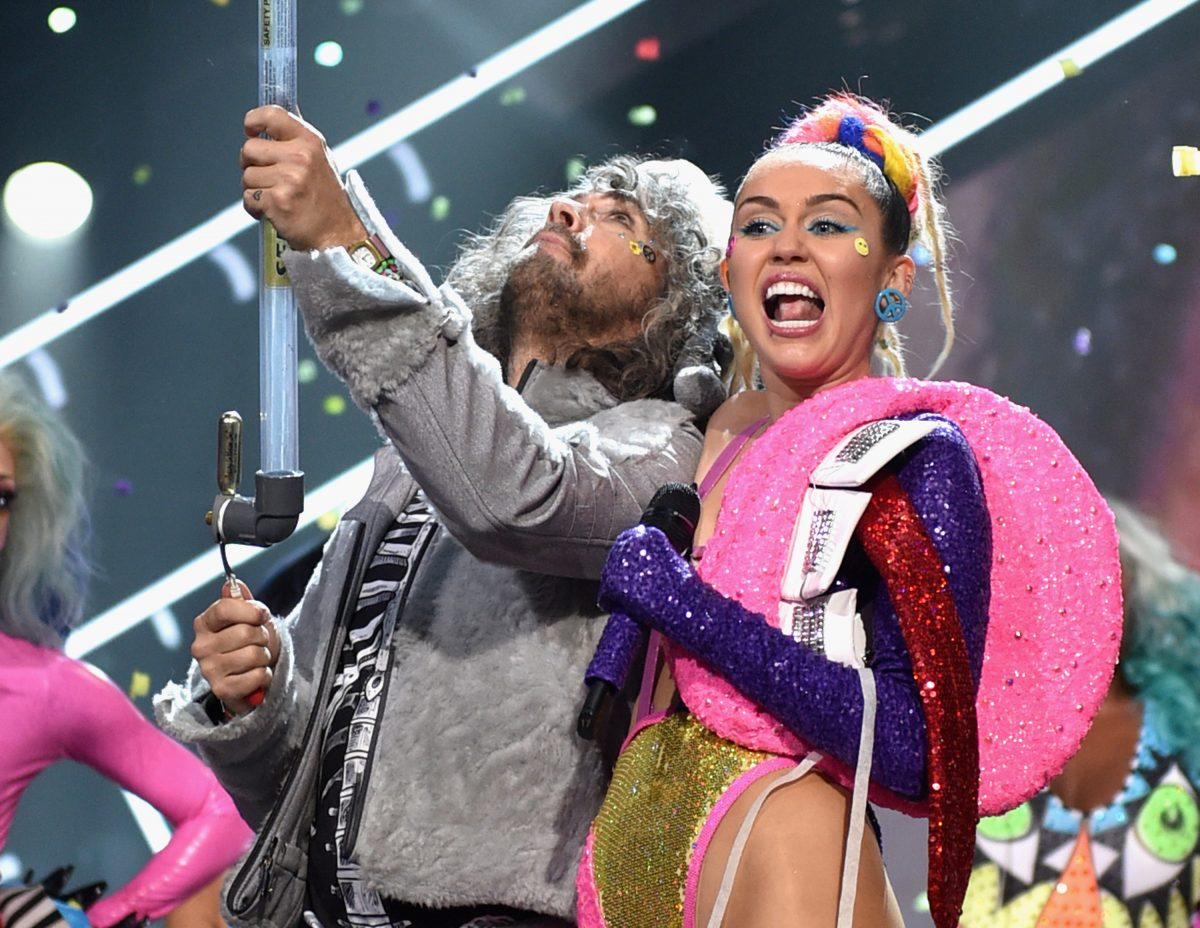 Wayne Coyne of The Flaming Lips (L) and Miley Cyrus perform onstage during the 2015 MTV Video Music Awards on August 30, 2015