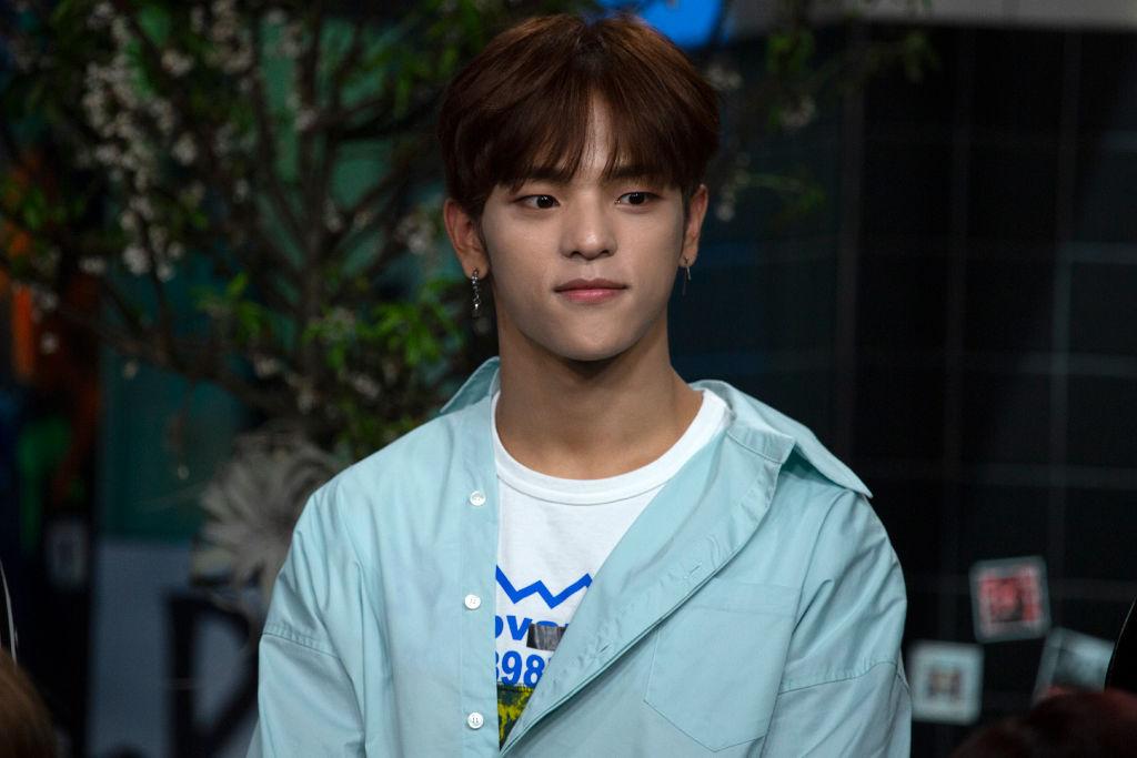 Woojin in a blue shirt