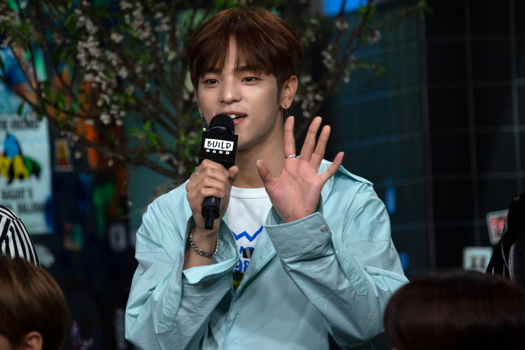 Woojin holding a microphone