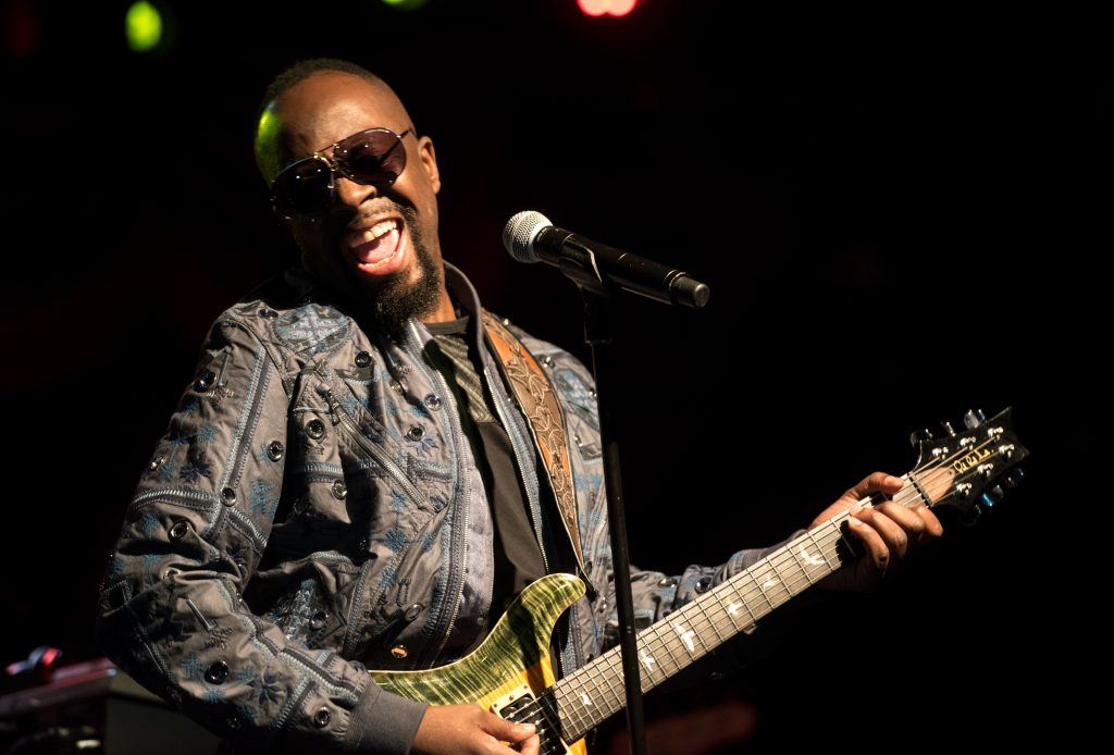 Wyclef Jean with a guitar