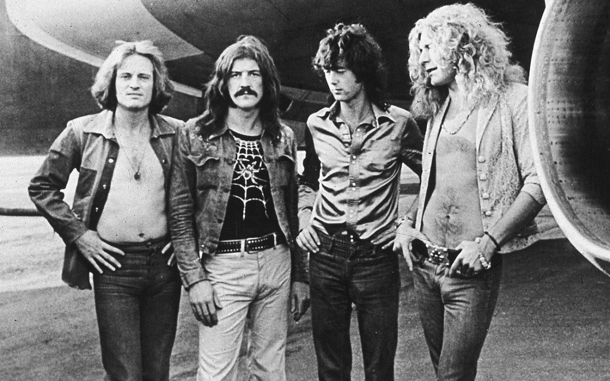 Led Zeppelin posed at the band jet