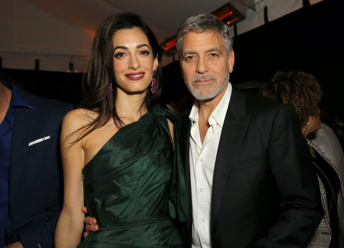 Amal Clooney and George Clooney pose together attend the premiere of Hulu's 'Catch-22'