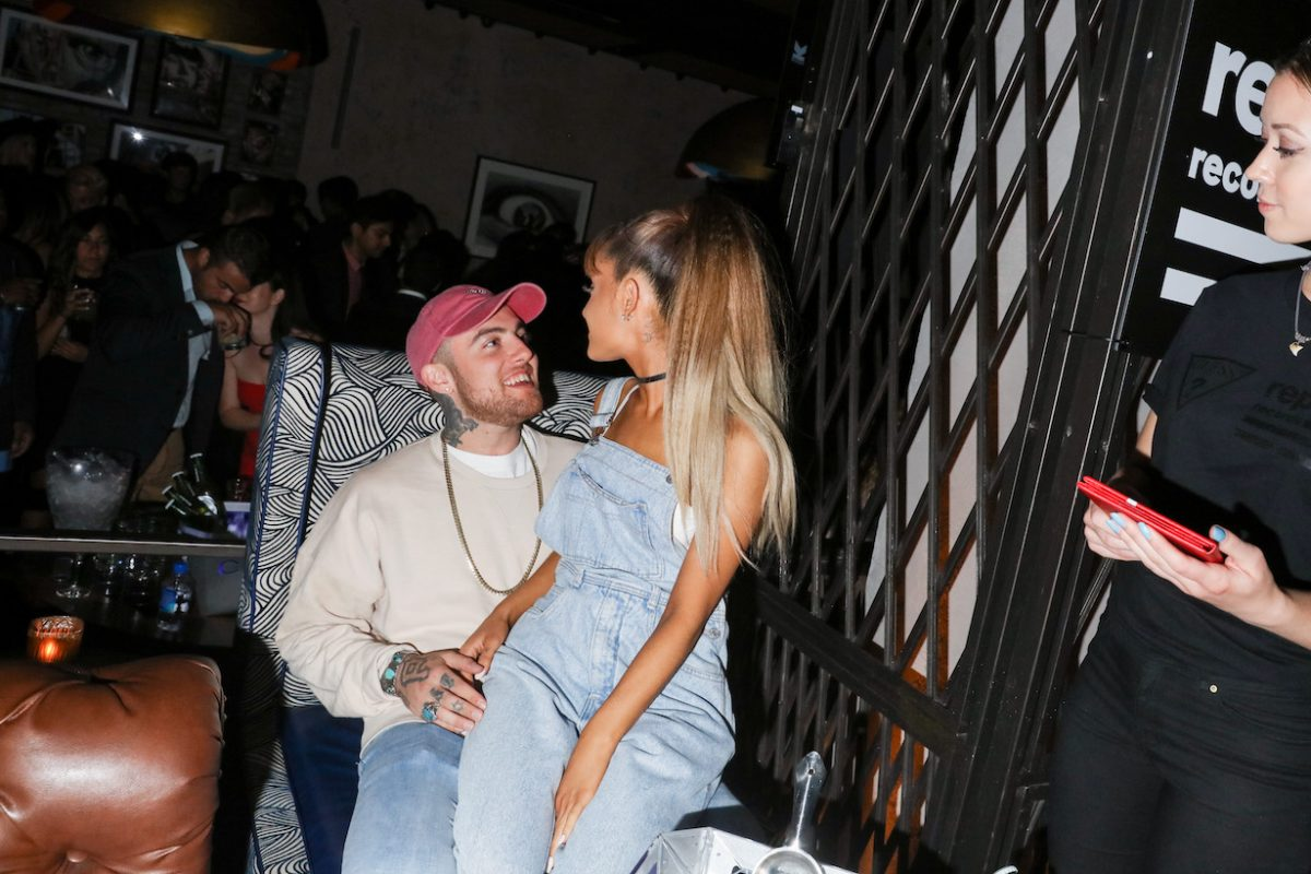 Ariana Grande sitting on Mac Miller's lap at the Republic Records 2016 VMA afterparty in 2016