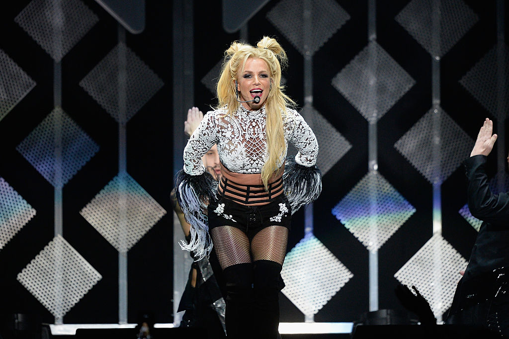 Britney Spears performing on stage, singing