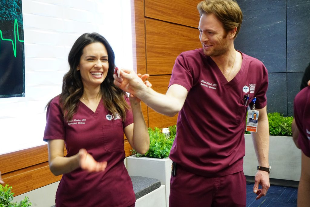 (L-R) Torrey Devitto and Nick Gehlfuss in costume on 'Chicago Med' laughing