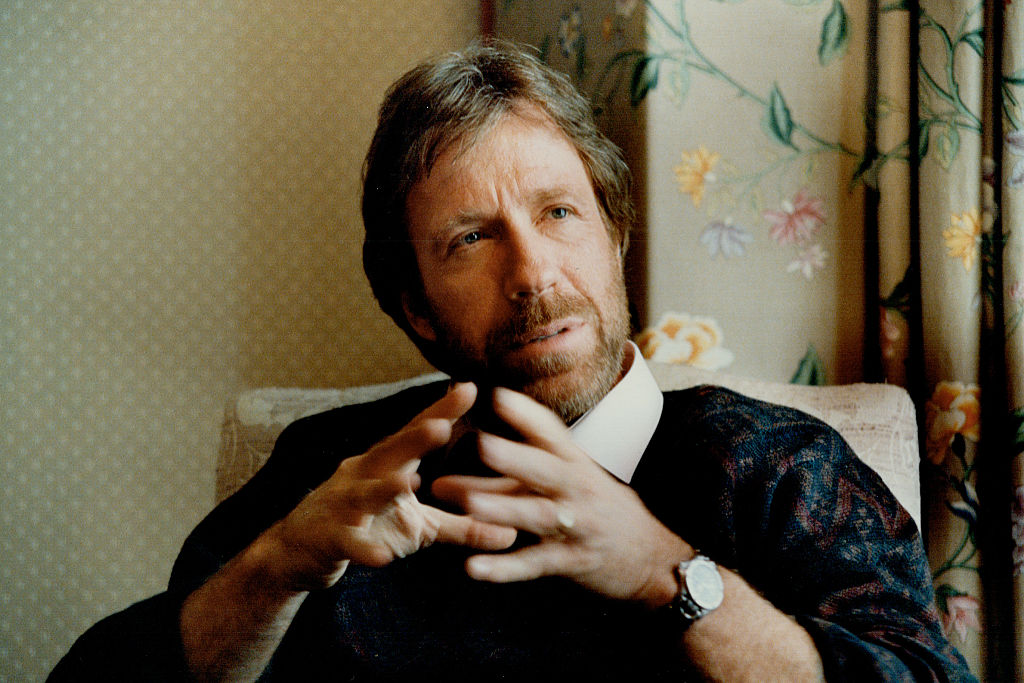 Chuck Norris, turned slightly to the right, gesturing while talking