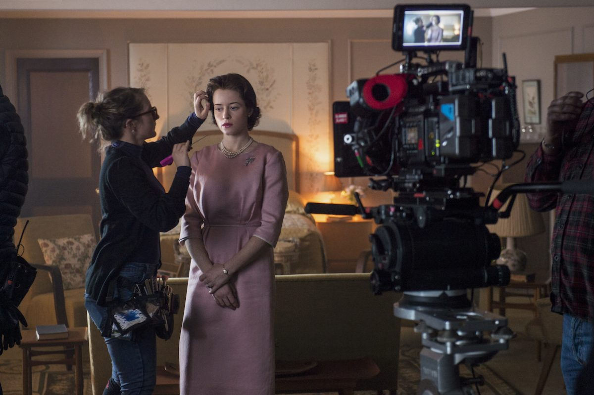 Claire Foy during a hair and makeup touch up on the set of 'The Crown' Season 2 Episode 1