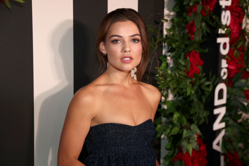 Danielle Campbell standing in front of a black and white striped backdrop