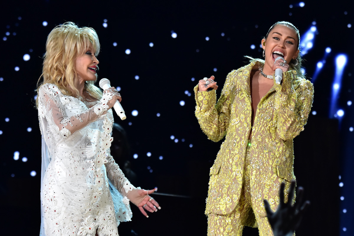 Dolly Parton and Miley Cyrus perform onstage