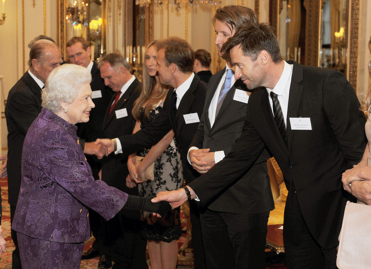 Queen Elizabeth II and Hugh Jackman at Buckingham Palace