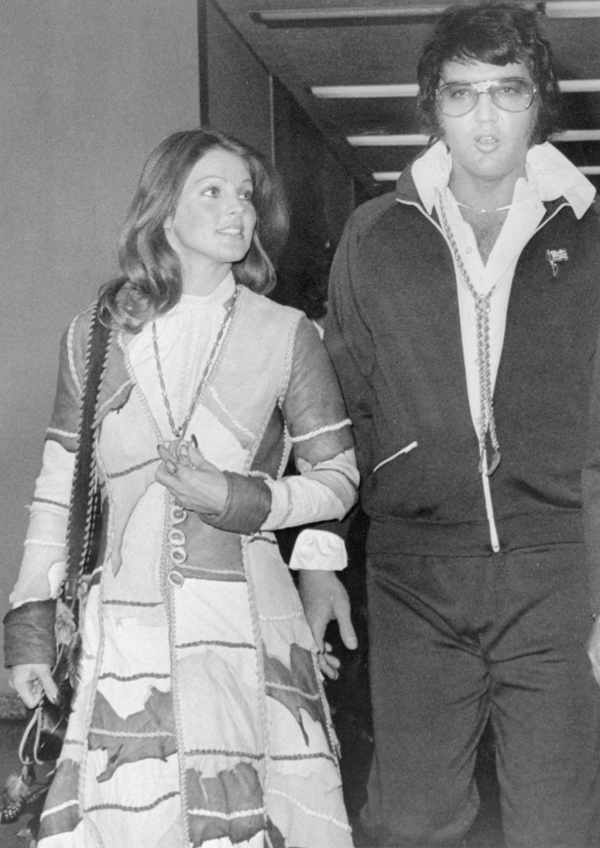 Elvis Presley leaves Santa Monica California Superior Court after being granted a divorce from his wife Priscilla