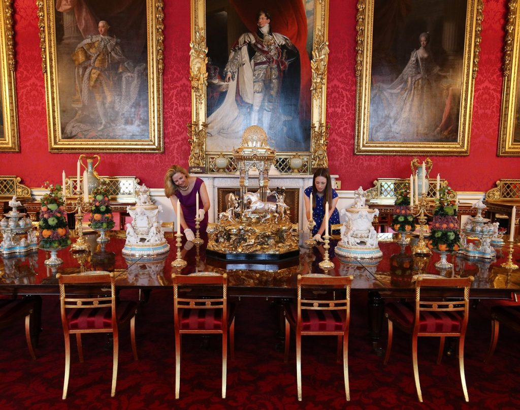 Employees adjust placings at a recreation of a Victorian dinner in Buckingham Palace