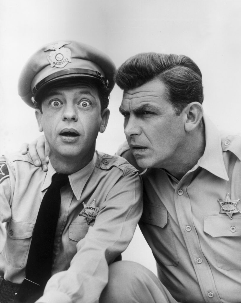 Don Knotts as Barney Fife and Andy Griffith as Sheriff Andy Taylor