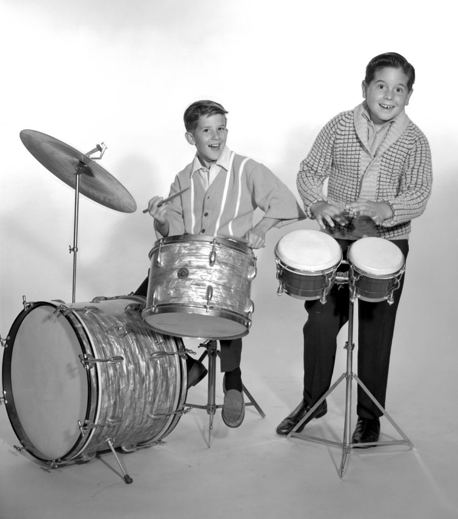 Keith Thibodeaux, left, with Lucille Ball and Desi Arnaz's real-life son, Desi Arnaz Jr., 1962