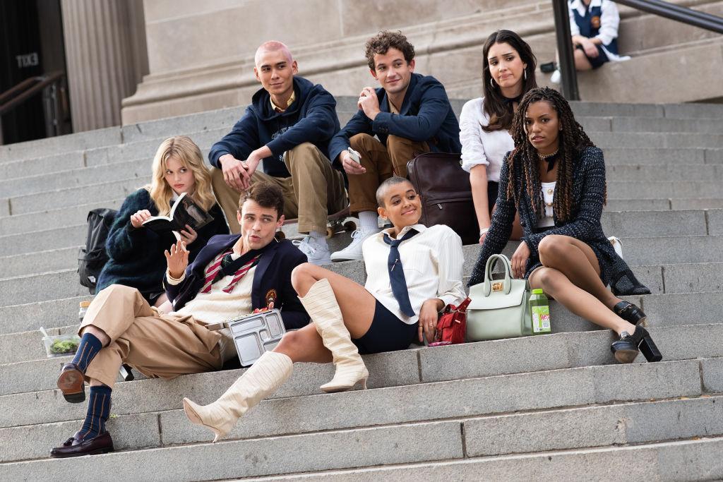 Evan Mock, Eli Brown, Zión Moreno, Emily Alyn Lind, Thomas Doherty, Jordan Alexander and Savannah Lee Smith sitting on the steps of the Metropolitan Museum of Art