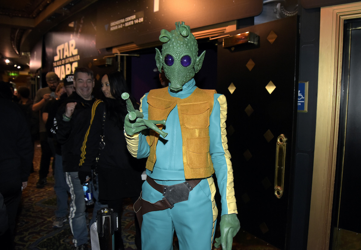 A fan dressed as the 'Star Wars' character Greedo