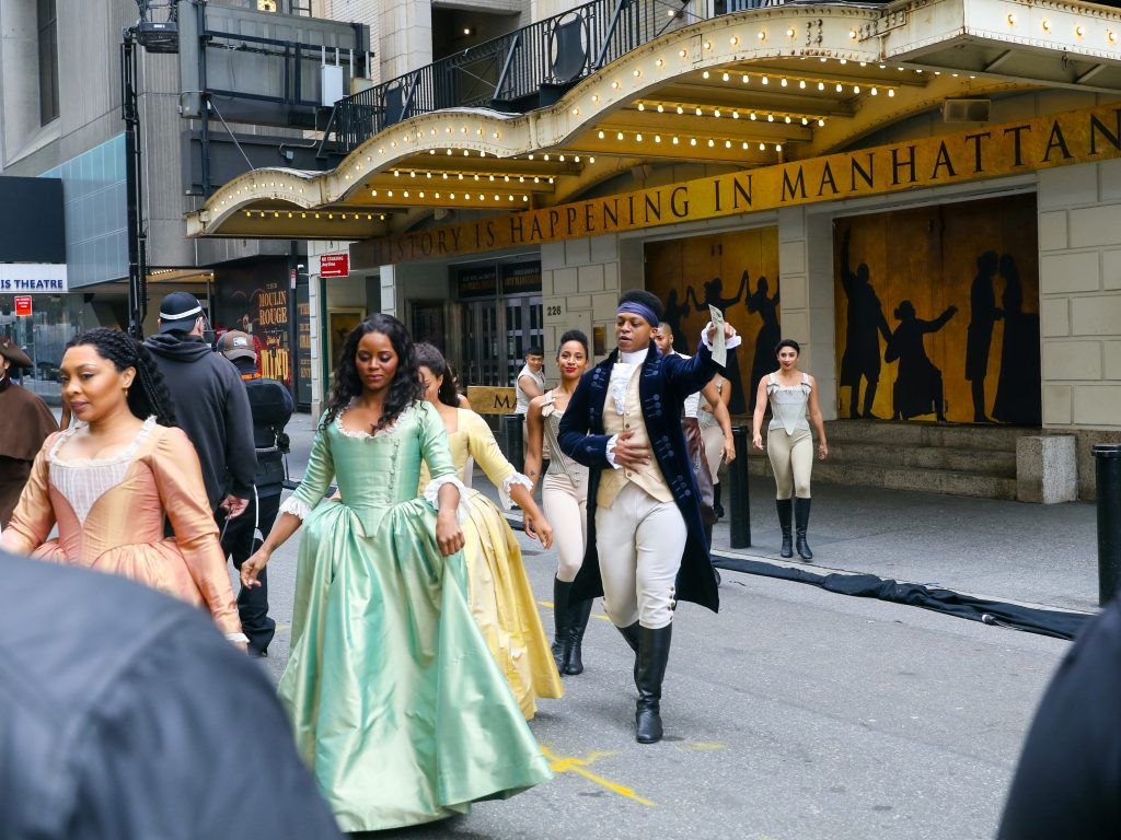 The cast of the Broadway show 'Hamilton' pictured pre-taping a show for the Macy's Thanksgiving Day Parade show outside the Richard Rogers Theater in New York City