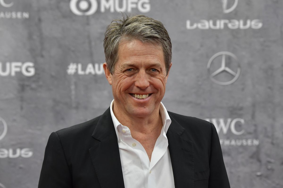 Hugh Grant poses on the red carpet