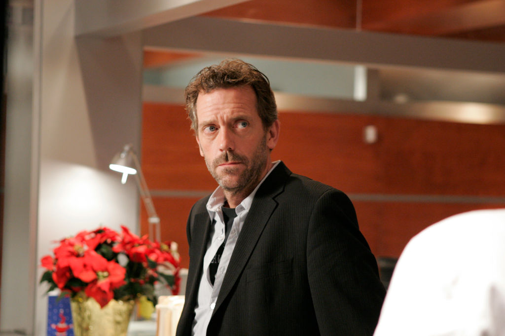 Hugh Laurie as Dr. Gregory House, turned to the side