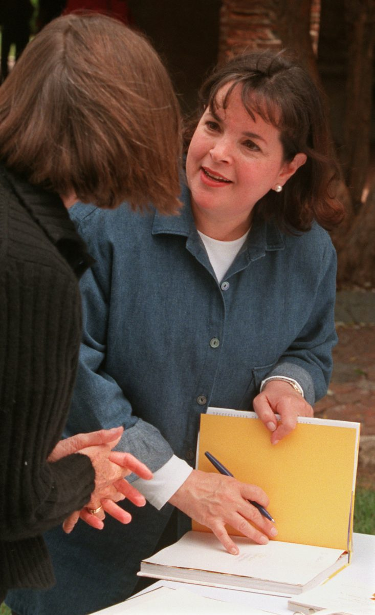Ina Garten speaks to a fan while signing one of her cookbooks