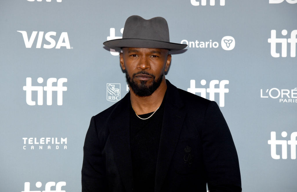 Jamie Foxx in front of a blue background