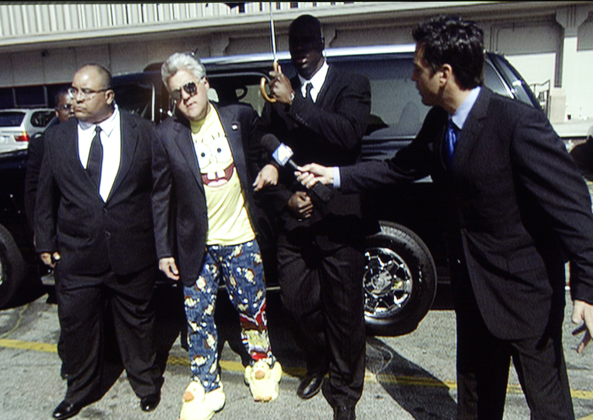 "Jay Leno arrives to the studio to film ""Tonight Show"" on March 10, 2005.  Leno is wearing Sponge Bob Square Pants pajamas, bunny slippers and is flanked by bodyguards to parody Michael Jackson's arrival to the courthouse in Santa Maria"