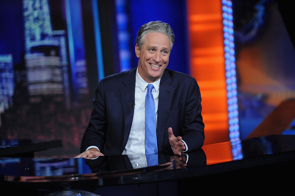Jon Stewart smiling on 'The Daily Show'