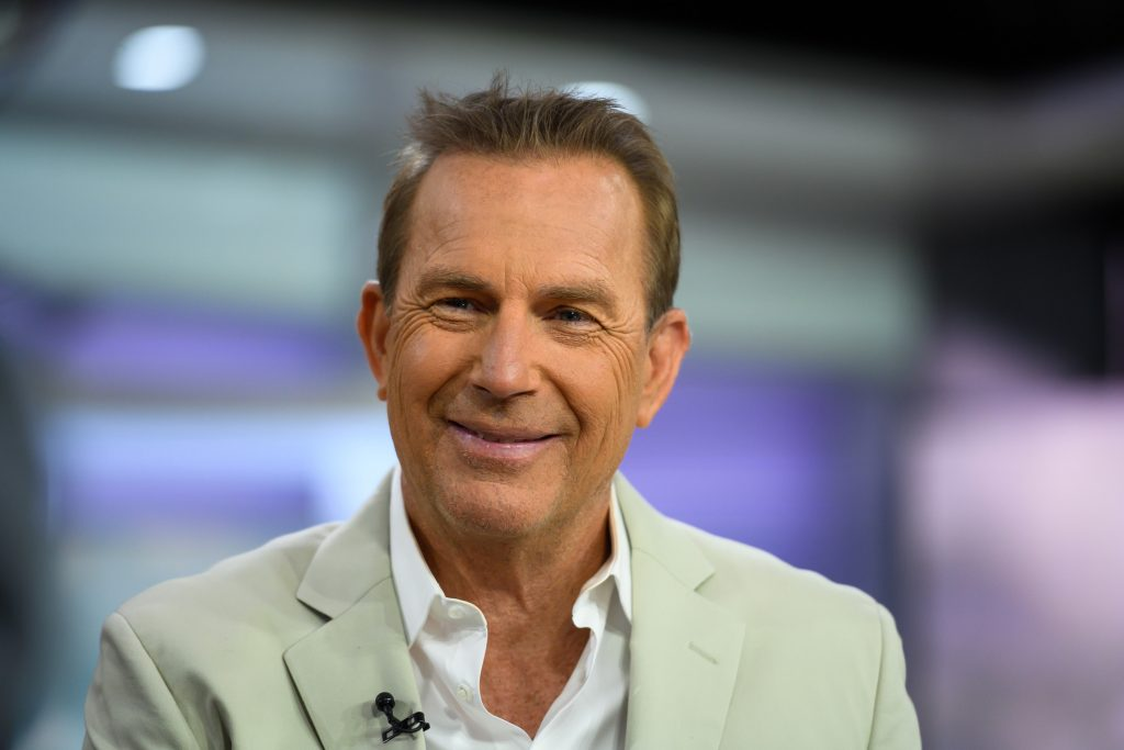 Kevin Costner smiles for a photo