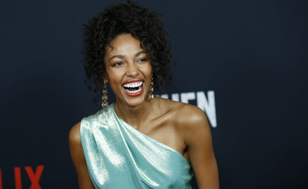 Kylie Bunbury smiles for a photo on the red carpet