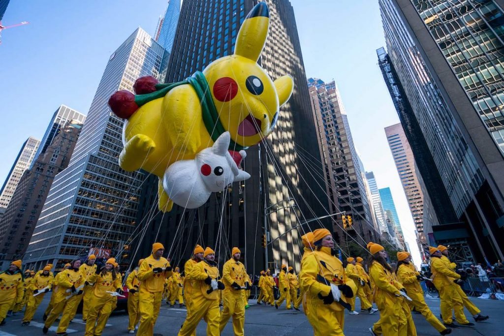 Pikachu (top) and Snow Pikachu fly over 6th Avenue during the 92nd Annual Macy's Thanksgiving Day Parade on November 22, 2018