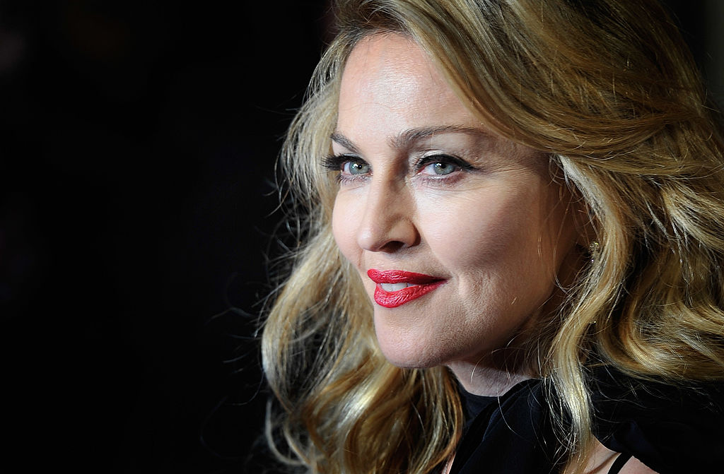 Madonna smiling, looking to the side