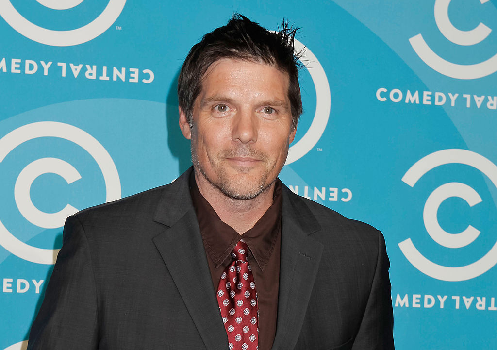 Paul Johansson smiling in front of a blue background